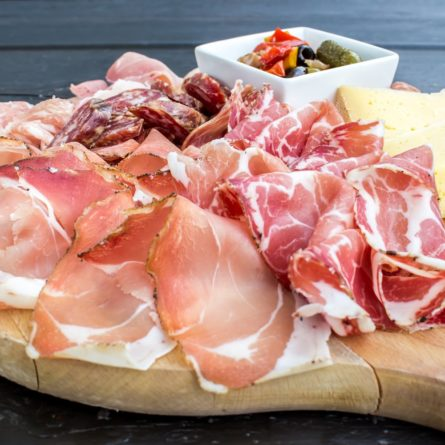 typical Italian appetizer with salami, cheese and pickles