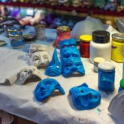Preparations for making Venetian masks, and accessories of the artist in the creative workshop in Venice.
