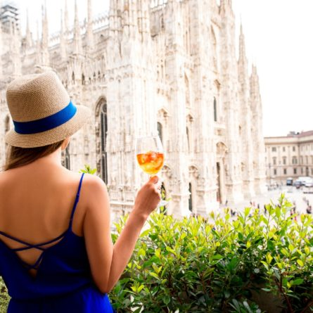 Woman with spritz aperol drink in Milan