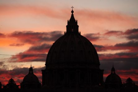 Sunset over the dome of Saint Peter's Basilica in Vatican City.