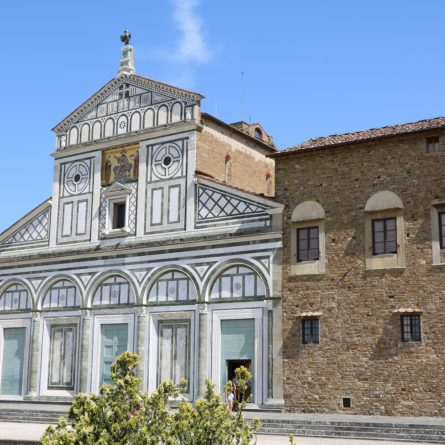 Basilica San Miniato al Monte under blue sky in Florence, Italy
